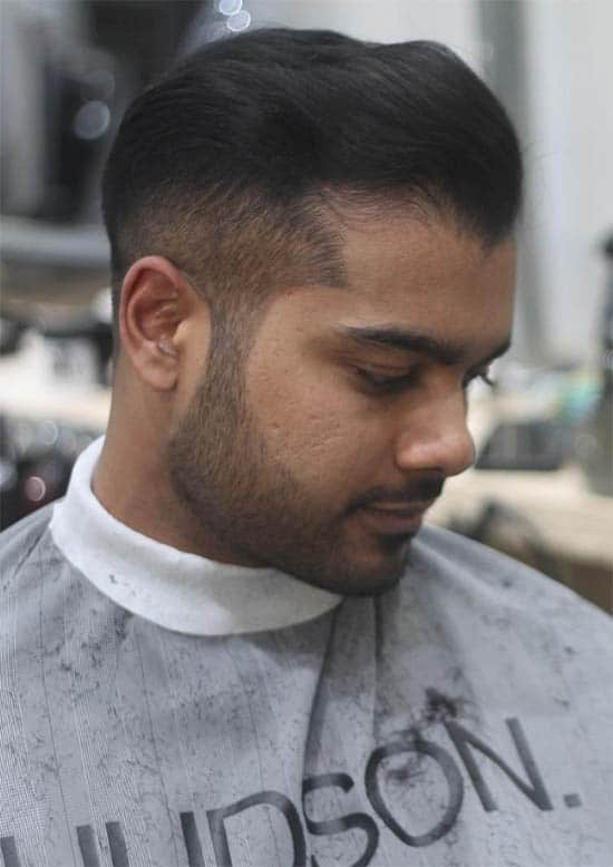 Brushed Back Hair - Mid Fade Haircuts For The Stylish Man