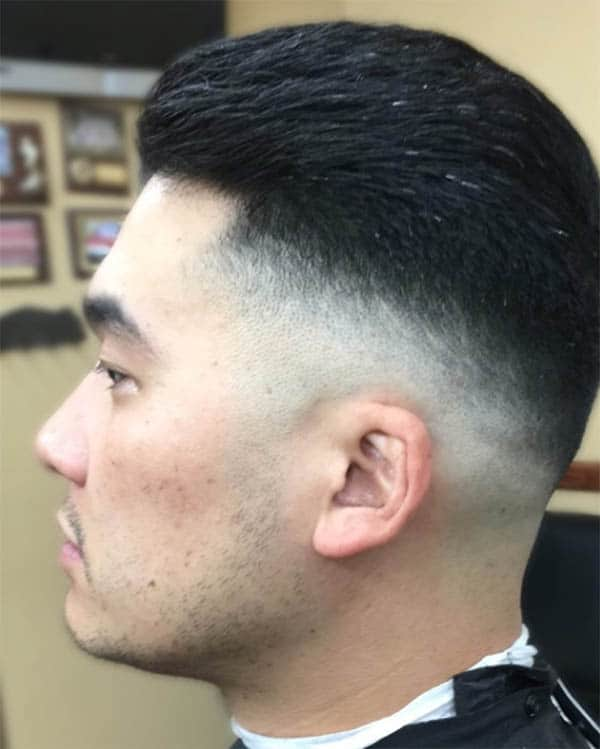 Medium Slick Back Haircut For Men